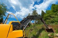 Yellow and Black Excavator Machine Stock Photo
