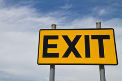Yellow and Black Exit Sign against the sky Royalty Free Stock Photos