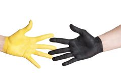 Yellow black hand giving Stock Photography