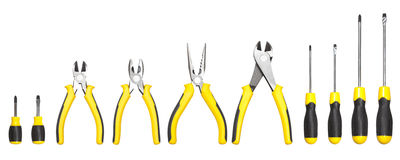 Yellow and black handy tools (pilers and screwdriver) Stock Photos