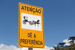 Yellow and black horse road sign in Brazil Stock Images