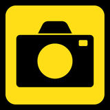 Yellow, black information sign - camera icon. Yellow rounded square information road sign with black camera icon and frame Royalty Free Stock Photography