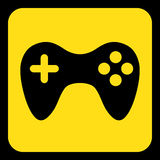 Yellow, black information sign - gamepad icon. Yellow rounded square information road sign with black gamepad icon and frame Stock Image