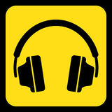 Yellow, black information sign - headphones icon. Yellow rounded square information road sign with black headphones icon and frame Royalty Free Stock Photography