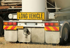 Yellow and black long vehicle sign on back of truck Stock Photos