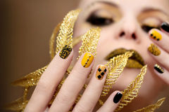Yellow black manicure. Stock Images