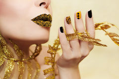 Yellow black manicure. Royalty Free Stock Photo