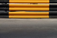 Yellow and black metal barriers blocking on the road Stock Photography