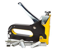 It is yellow the black metal stapler for repair work on the house Royalty Free Stock Images