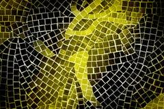Yellow and black mosaic tile wall. Rough yellow and black mosaic tile wall in bathroom Stock Photo
