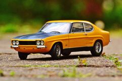 Yellow and Black Muscle Car in Tilt Shift Photography Stock Photography
