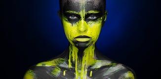 Yellow black paint Makeup Beauty Girl Stock Photography