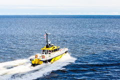 Yellow and Black Pilot Boat Cutting Through Blue Water Royalty Free Stock Photos