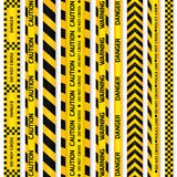 Yellow with black police line and danger tapes. Royalty Free Stock Photography