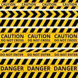 Yellow with black police line and danger tapes Stock Photo