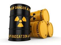 Yellow and black radioactive barrels Stock Photos