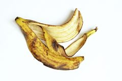 Yellow and black ripe banana skin. stock photos