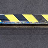 Yellow black tape. Yellow and black safety tape at step warning royalty free stock photo