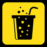 Yellow, black sign - carbonated drink with straw Stock Photography