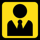 Yellow, black sign - figure with suit and necktie. Yellow rounded square information road sign with black figure with suit and necktie icon and frame Stock Photo
