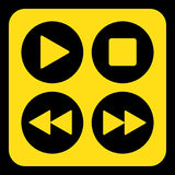 Yellow, black sign - four music control buttons Stock Photo