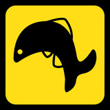 Yellow, black sign - jumping fish, dolphin icon. Yellow rounded square information road sign with black jumping fish, dolphin icon and frame Royalty Free Stock Photography