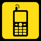 Yellow, black sign - old mobile phone with antenna. Yellow rounded square information road sign - black old mobile phone with antenna and signal icon and frame Royalty Free Stock Photography