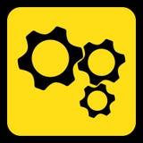 Yellow, black sign - three cogwheel icon Stock Images