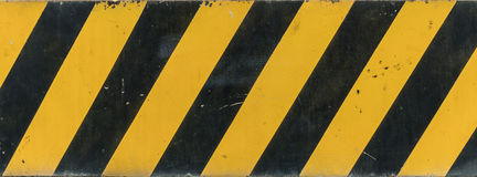 Yellow and black sign Royalty Free Stock Photo