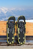 Yellow and black snowshoe. On bench Royalty Free Stock Photo