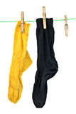 Yellow and black socks hanging on rope Royalty Free Stock Photography