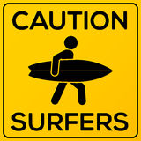 Yellow and black square caution sign with surfer Stock Images