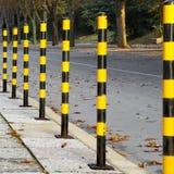 Yellow Black Street Posts Royalty Free Stock Photography