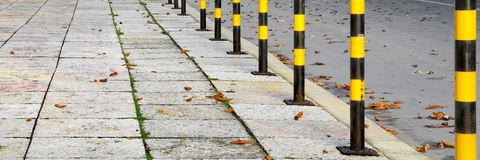 Yellow Black Street Posts Royalty Free Stock Images