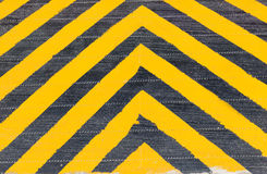Yellow and Black Stripe warning sign on the danger area Stock Image