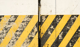 Yellow and black stripes on the concrete surface Royalty Free Stock Image