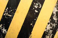 Yellow and black stripes on the concrete surface Stock Images