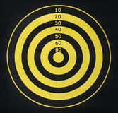 Yellow and black target. Front view of yellow and black dart game Stock Photo