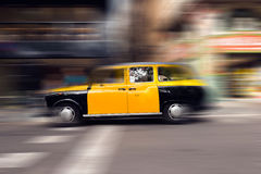 Yellow and Black Taxi - Barcelona Spain Stock Image