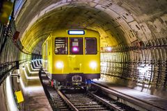 Yellow and Black Train Under Tunnel stock photography