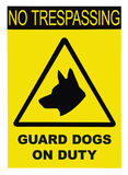 Yellow black triangle No Trespassing Guard Dogs On Duty Text Sign, isolated, large detailed closeup Stock Photo