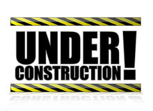Yellow and black under construction sign Stock Photo