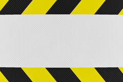 Yellow and black warning sign Royalty Free Stock Photo