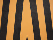 Yellow and black warning sign Stock Images