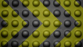 Yellow and black warning sign on bubble texture. Stock Image