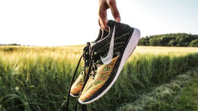 Yellow Black and White Nike Running Shoes Royalty Free Stock Photography