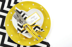 Yellow black and white theme Happy New Year table setting Royalty Free Stock Photo