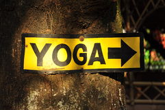 Yellow and black yoga signboard Royalty Free Stock Photo