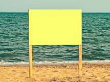 Yellow blank billboard on sandy beach.Just add your text. Stock Photos