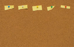 Yellow blank note on Cork board Stock Photo